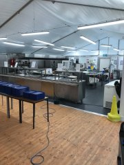 7 full commercial kitchen capable of producing 750 meals per day in the temporary kitchen.jpg
